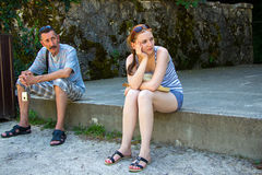 Tourists are tired and sitting Royalty Free Stock Image