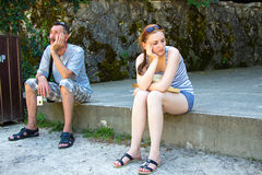 Tourists are tired sitting and waiting Royalty Free Stock Photo