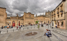 Tourists in Toledo, Spain. Toledo, Spain - May 28, 2016: Tourists rest and walk in the Calle de los Reyes Catolicos in Toledo, Spain on May 28, 2016 Stock Photos
