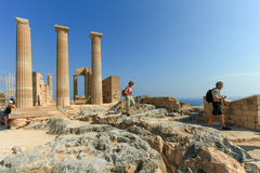 Tourists at the top of Lindos ancient Acropolis ruins Royalty Free Stock Image
