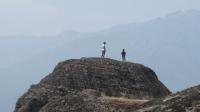 Tourists on the top of the Meteor in Greece stock footage