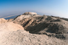 Tourists on the top of Mount Sodom. Royalty Free Stock Images