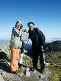 Tourists on the top of mountains. Tourists in Retezat Mountains National Park (Peleaga Peak, 2509 m Stock Image