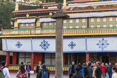 Tourists toss many coin to the top of stone pillar for lucky  in the center of Rumtek Monastery in winter near Gangtok. Sikkim Stock Photography