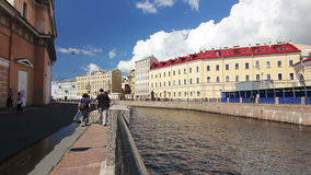 Tourists and Tourboat in inland river. St. Petersburg, Russia stock video footage