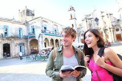 Tourists - tourist couple travel in Havana, Cuba. Tourists couple travel in Havana, Cuba having fun. Young multiracial happy couple on backpacking vaction Stock Photo