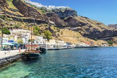 Tourists and tourist ship in the old port in Fira Royalty Free Stock Image