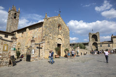 Tourists in town square of Monteriggioni Stock Photography
