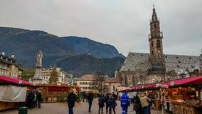Tourists the traditional annual Christmas Market in the famous Walther Square in Bolzano, South Tyrol stock image