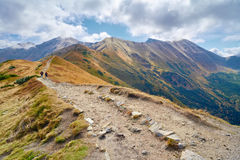 Tourists on trail in Tatras, Poland. High mountain Stock Images