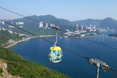 Tourists travel in cable car in the ocean park, Hong Kong Royalty Free Stock Image