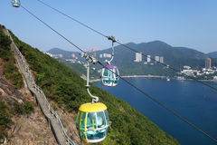 Tourists travel in cable car in the ocean park, Hong Kong Royalty Free Stock Photos