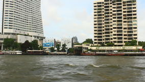 Tourists travel on the Chao Phraya river on a boat. Bangkok, Thailand, Tourists travel on the Chao Phraya river on a boat stock video footage