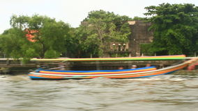 Tourists travel on the Chao Phraya river on a boat. Bangkok, Thailand, Tourists travel on the Chao Phraya river on a boat stock footage