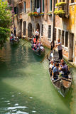 Tourists travel  on a gondolas Stock Photos