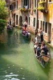 Tourists travel  on a gondolas Stock Photos