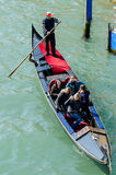 Tourists travel on gondolas at canal  in venice italy Royalty Free Stock Photo