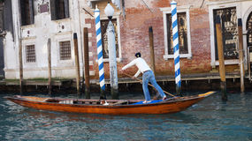 Tourists travel on gondolas at canal in Venice, Italy Royalty Free Stock Photo