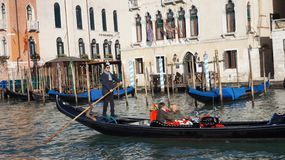 Tourists travel on gondolas at canal in Venice, Italy Royalty Free Stock Image