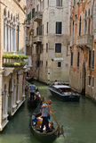 Tourists travel on gondolas at canal  in Venice Royalty Free Stock Photography