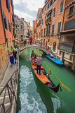 Tourists travel on gondolas at canal Royalty Free Stock Image