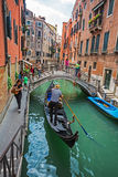 Tourists travel on gondolas at canal Royalty Free Stock Images