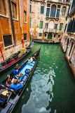 Tourists travel on gondolas at canal Stock Photo