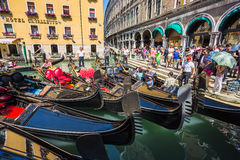 Tourists travel on gondolas at canal Stock Image