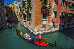 Tourists travel on gondolas at canal Stock Photography