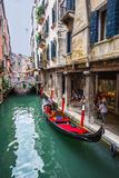 Tourists travel on gondolas at canal Royalty Free Stock Photos