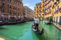 Tourists travel on gondolas at canal Royalty Free Stock Photography