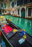 Tourists travel on gondolas at canal Stock Images