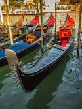 Tourists travel on gondolas at canal Stock Photo