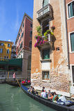 Tourists travel on gondolas at canal Royalty Free Stock Photo
