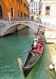 Tourists travel on gondolas  in Venice Royalty Free Stock Photo