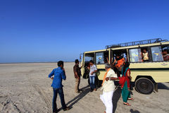 Tourists travel by a hired van in Dhanushkodi, Tamil Nadu, India. Royalty Free Stock Photography