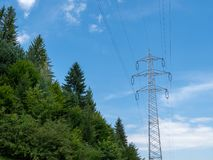 Electricity pylon near the forest royalty free stock images