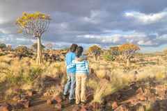 Tourists travel in South Africa. Quiver tree forest landscape, couple of tourists looking at beautiful view. Kokerbooms in Namibia, South Africa. African nature Royalty Free Stock Photos