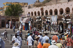 Tourists Travel to Nubian Market Bazaar, Egypt. Tourists on holiday and vacation who are visiting sites of ancient Egypt stop at an open air market and Bazaar in Royalty Free Stock Photos