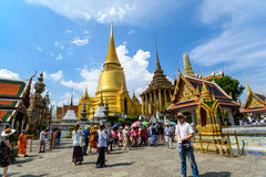 Tourists travel to Wat Phra Kaew and Grand Palace in Bangkok, Thailand. Stock Photography