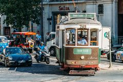 Tourists Travel By Tram 28 In Downtown Lisbon City. LISBON, PORTUGAL - AUGUST 09, 2017: Tourists Travel By Tram 28 In Downtown Lisbon City Stock Images