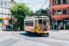 Tourists Travel By Tram 28 In Downtown Lisbon City. LISBON, PORTUGAL - AUGUST 09, 2017: Tourists Travel By Tram 28 In Downtown Lisbon City Stock Image