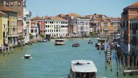 Tourists travel by vaporettos in Venice, beautiful view of Grand Canal, Italy. Stock footage stock video