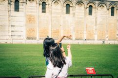 Tourists traveler asian chinese, japanese female women girls are posing, having fun, make stereotypical photos, show size, hold wi royalty free stock photography