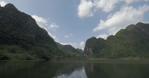 Tourists traveling by boats to see the landscapes of Trang An, Vietnam stock video
