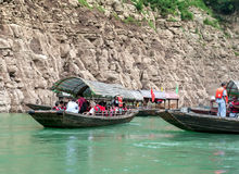 Tourists traveling by canoe on the Yangtze River Stock Photo