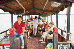 Tourists traveling through the channels of the Mekong delta. Vie Royalty Free Stock Image