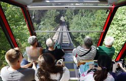 Tourists traveling on funicular Railway from interlaken to Harder Kulm Stock Photos
