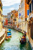 Tourists traveling in gondola, Rio Marin Canal, Venice, Italy royalty free stock images