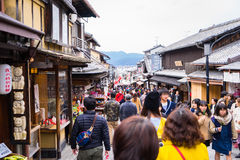 Tourists are traveling in Kyoto traditional shopping street. Stock Photos